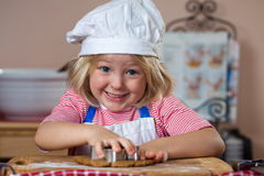 Cute smiling boy baking gingerbread Royalty Free Stock Photography