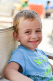 Cute  smiling boy. Beautiful blond  smiling  little boy looking at the camera Royalty Free Stock Image