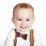 Cute smiling boy with bow-tie Royalty Free Stock Photos