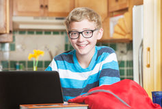 Cute smiling boy in glasses with laptop Royalty Free Stock Photo