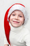 Cute smiling boy in hat of Santa Royalty Free Stock Images