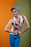 Cute, smiling boy in hat, tank, and jeans Royalty Free Stock Photo