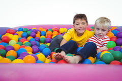 Cute smiling boys in sponge ball pool Stock Photography