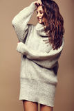 Cute smiling brunette woman girl in casual hipster warm gray sweater Royalty Free Stock Images