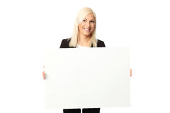 Cute smiling businesswoman with whiteboard Royalty Free Stock Image