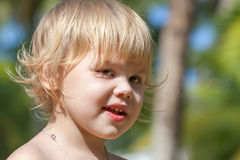 Cute smiling Caucasian blond baby girl portrait Stock Image
