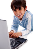 Cute smiling caucasian kid with laptop Stock Photos