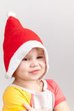 Cute smiling Caucasian little girl in red Santa hat Royalty Free Stock Photography