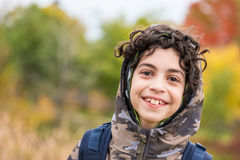 Cute Smiling Child Boy with Autumnal Background Royalty Free Stock Image
