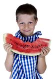 Cute smiling child holding a watermelon slice. Portrait isolated on white of cute happy child holding a big watermelon slice Royalty Free Stock Image