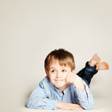 Cute Smiling Child. Little Boy Dreaming and Looking Up royalty free stock photography