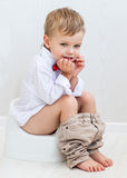 Cute smiling child on a pot Royalty Free Stock Photo