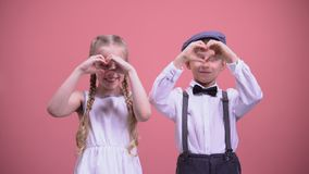 Cute smiling children making hearts with their hands, celebrating Valentines day stock footage