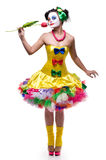 Cute smiling clown. Full-length portrait of Proud Clown Displaying a Flower Royalty Free Stock Photos