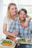 Cute smiling couple enjoying a meal together Royalty Free Stock Photos
