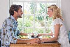 Cute smiling couple having a meal together Royalty Free Stock Image