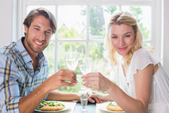 Cute smiling couple having a meal together Royalty Free Stock Photos