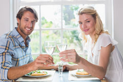 Cute smiling couple having a meal together Royalty Free Stock Photo