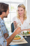 Cute smiling couple having a meal together Royalty Free Stock Photography