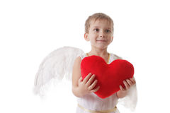 Cute smiling cupid with heart in a hands Royalty Free Stock Image