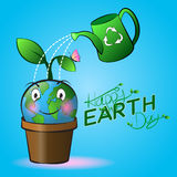 Cute smiling Earth cartoon on a pot with watering and blue background. Royalty Free Stock Photo