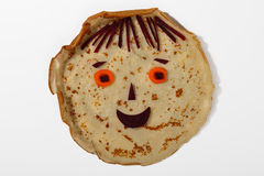 Cute smiling face from pancake, carrot and beet Royalty Free Stock Images