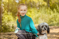 Cute smiling freckled girl posing with dog Stock Photo