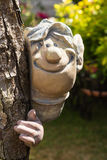 Cute, smiling garden ornament Royalty Free Stock Image