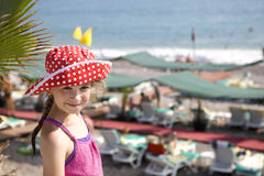 Cute smiling girl. Eight years old standing on beach stock images