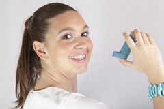 Cute smiling girl with asthma inhaler Royalty Free Stock Photo