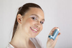 Cute smiling girl with asthma inhaler Stock Photo