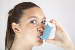 Cute smiling girl with asthma inhaler Stock Photos