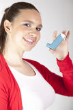 Cute smiling girl with asthma inhaler Royalty Free Stock Image