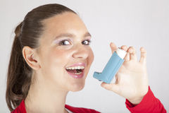 Cute smiling girl with asthma inhaler Royalty Free Stock Photography
