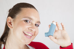 Cute smiling girl with asthma inhaler Stock Images
