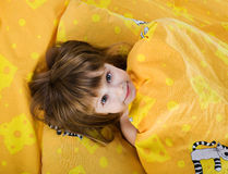 Cute smiling girl on bed Stock Photography