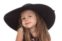 Cute smiling girl in big black hat Royalty Free Stock Photography