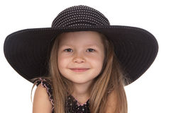 Cute smiling girl in big black hat Royalty Free Stock Photos