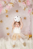 Cute smiling girl with a big Christmas ball royalty free stock photo