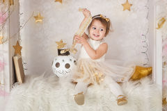 Cute smiling girl with a big Christmas ball stock images