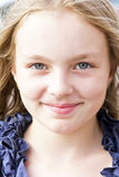 Cute smiling girl with blond hair Royalty Free Stock Images