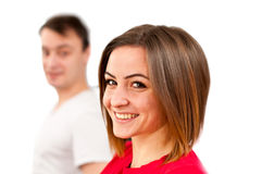 Cute smiling girl face with guy in background Stock Photo