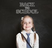 Cute smiling girl going to school for the first time. Back to school stock photo