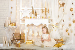 Cute smiling girl with gold stars Royalty Free Stock Photography