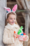 Cute smiling girl in a hare mask for the celebration of the International Easter Day Stock Image