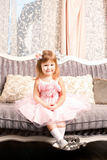 Cute smiling girl at home Stock Images