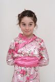 Cute smiling girl in Japanese costume Royalty Free Stock Photos