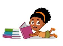 African american girl reading books. Cute smiling girl lying on the floor reading a book Stock Photos