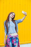 Cute smiling girl making selfie Stock Photography