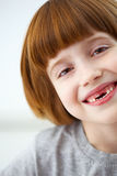Cute smiling girl missing front teeth Royalty Free Stock Photo